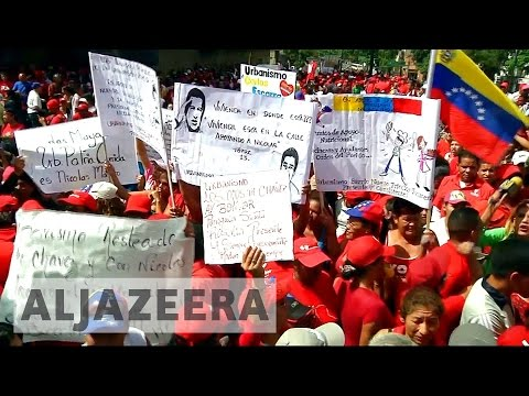 Two killed in mass protests across Venezuela