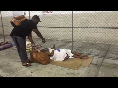 Nino brown blessing the homeless in Overtown