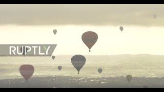 UK  Dozens of colorful hot air balloons soar at Bristol International Balloon Fiesta