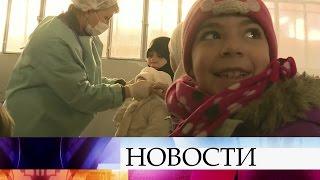 ВАлеппо наприем кроссийским врачам сирийцы идут целыми семьями.