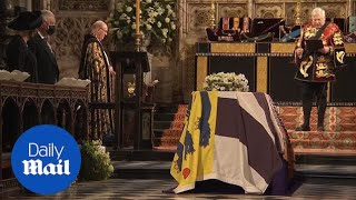Prince Philip's coffin is lowered through the chapel floor