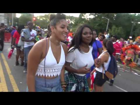 CARIBBEAN ISLANDS GIRLS DANCE TO SOCA MUSIC AROUND A FLOAT TRUCK AT CARNIVAL 2016