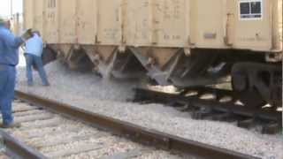 Application of Railroad Ballast from a Hopper railcar