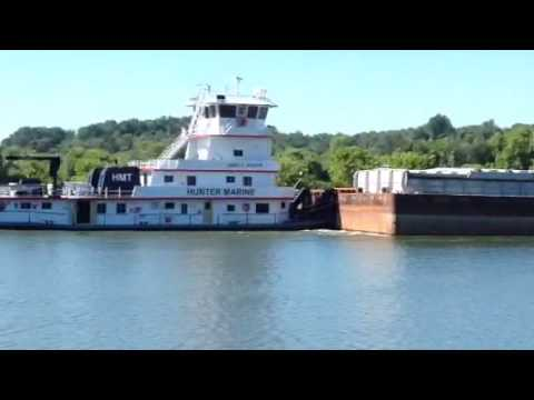 Hunter marine barge company going down the Cumberland river near Cheatham county dam.