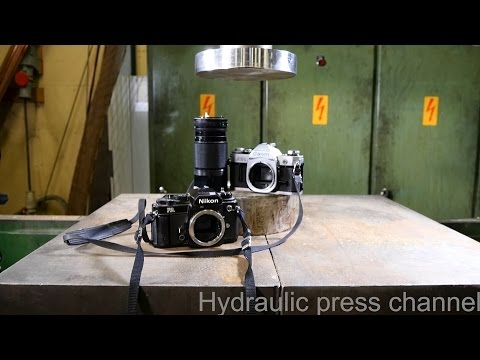 A hydraulic press makes film cameras more compact