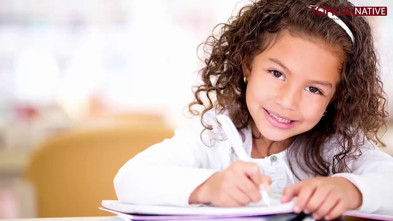 Child with ginger hair doing homework for parents helping wth homework  article Bringing Up Mummy   blogger