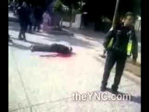 Black Man Shot by Police Dying on the Sidewalk as Angry Crowd gathers around Officers.wmv