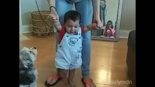 My little nephew is walking with his mom
