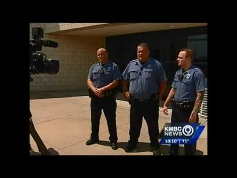 Police officers stop for pickup basketball game with Kansas City kids