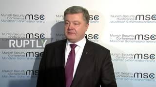Germany: Poroshenko hits out at Russia's validation of Donbass passports