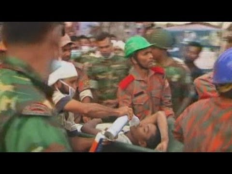 Survivors stretchered from collapsed Bangladesh garment building in Savar