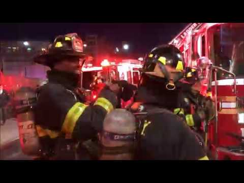 FDNY BOX 961 - FDNY BATTLING STUBBORN SMOKEY 4TH ALARM FIRE IN A MIXED ON FULTON STREET.
