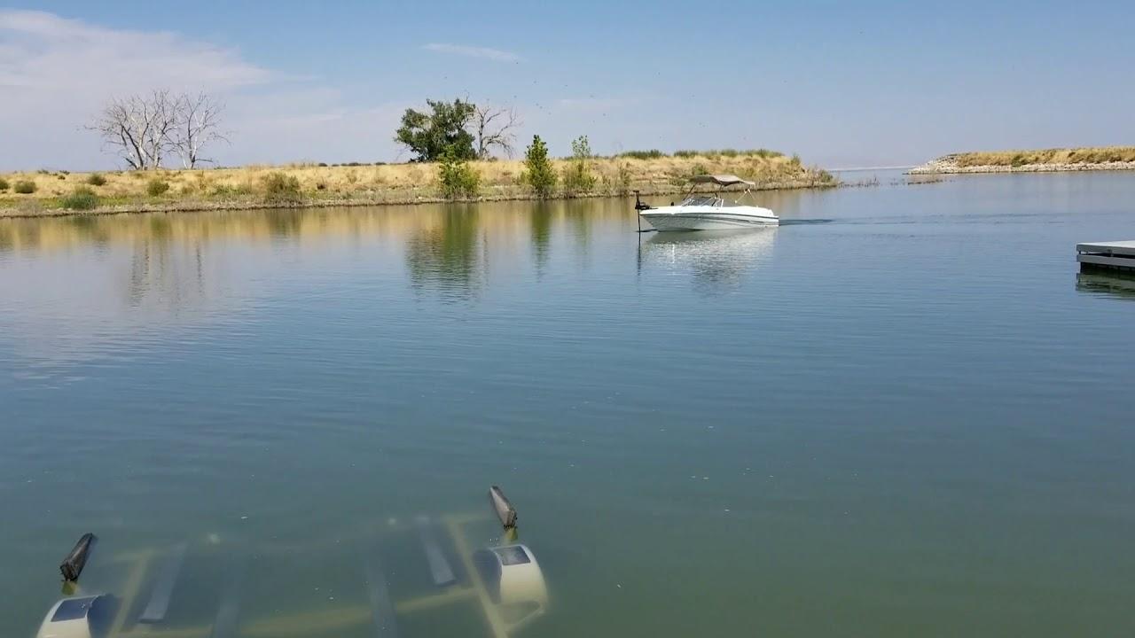 Landing boat on trailer using Minn Kota Ulterra - YouTube