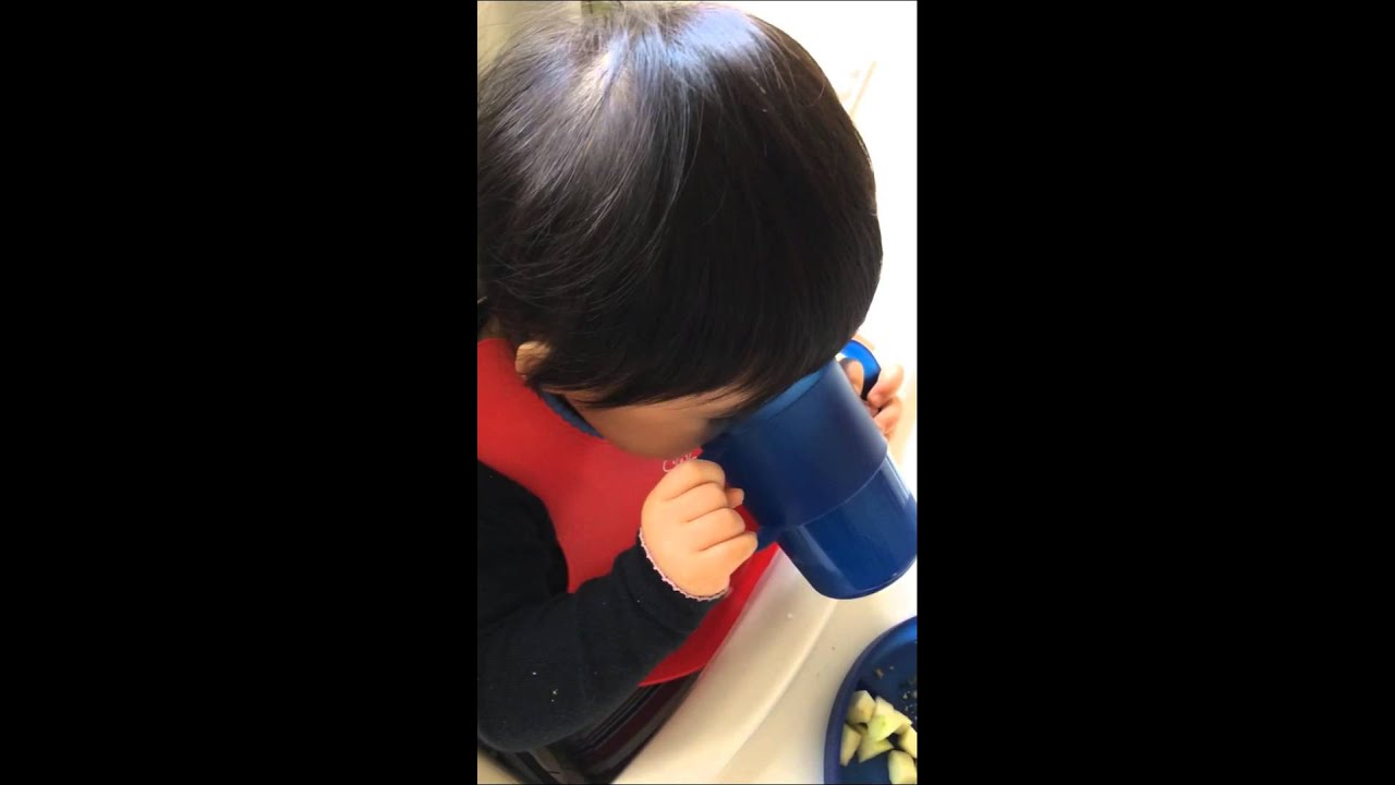 14m Josie first time drinking milk from a cup - YouTube