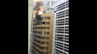 A fire in a building and a guy jumped