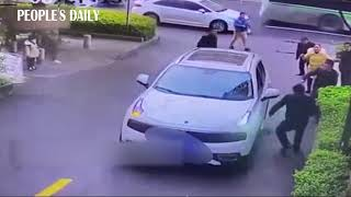 In less than 60 seconds, passers-by lifted a car after a boy was run over by the car and trapped