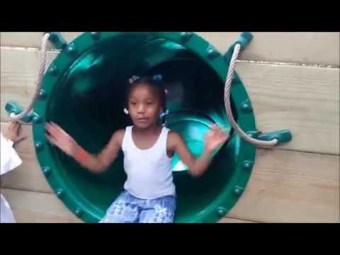 Thumbnail: Sassy little girl blocks the slide at the zoo