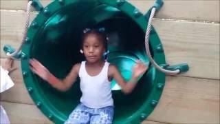 Sassy little girl blocks the slide at the zoo thumbnail