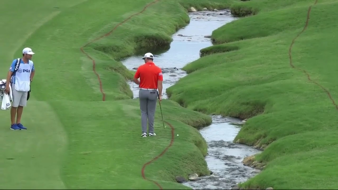Jon Rahm behind-the-back approach shot - YouTube