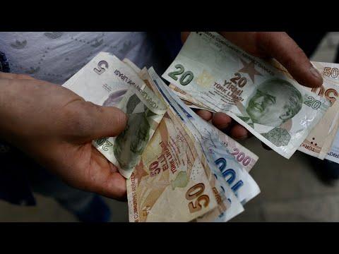 Turkish lira down sharply after Erdogan fires Central Bank Governor Naci Agbal