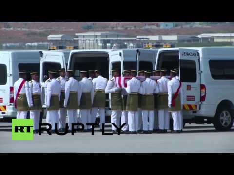 Malaysia: MH17 bodies arrive for national day of mourning