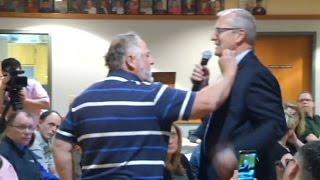 Watch a man stuff money in a GOP congressman's shirt at a heated North Dakota town hall