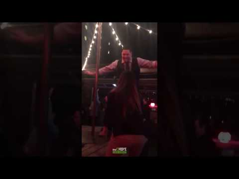 Intoxicated Man Attempts Pole Dance On Table And Fails Miserably