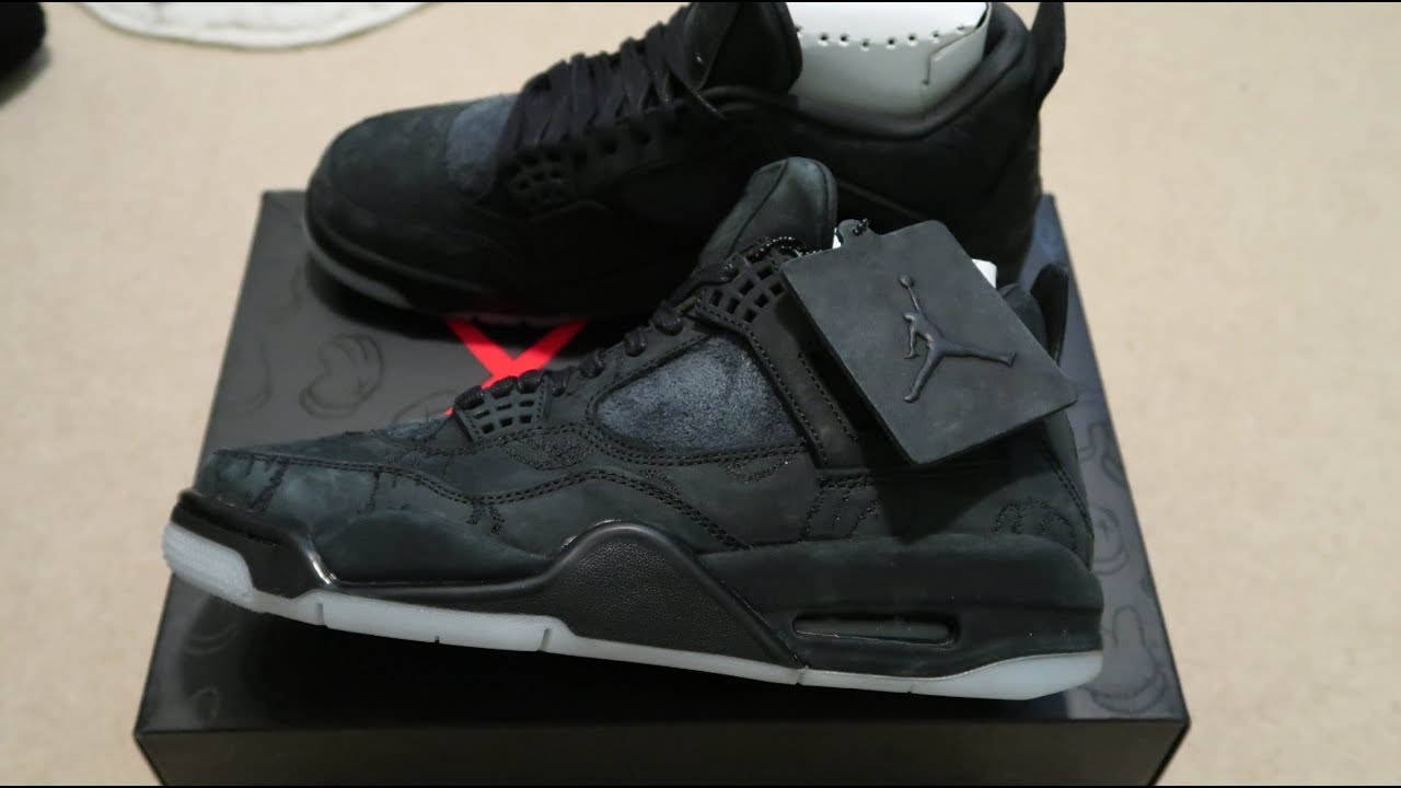 sports shoes 0b3a3 2f3ae Air Jordan 4 Retro Kaws 'Black' Sneaker Unboxing
