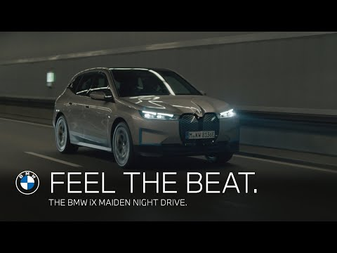 Feel the beat. The BMW iX maiden voyage through the night.