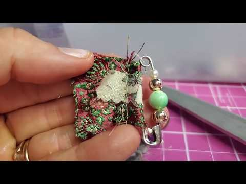 decorated-safety-pins-as-handmade-journal-tabs!