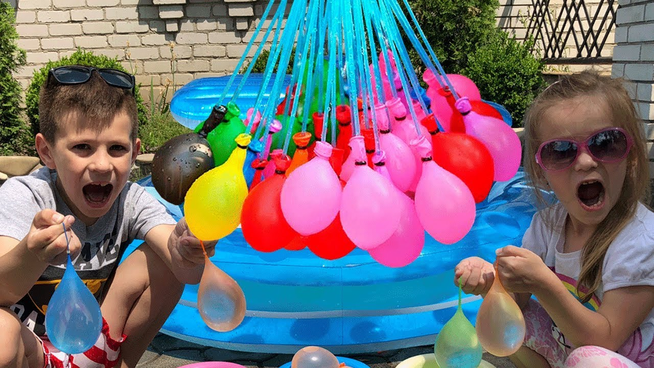 Kids playing with water table - YouTube