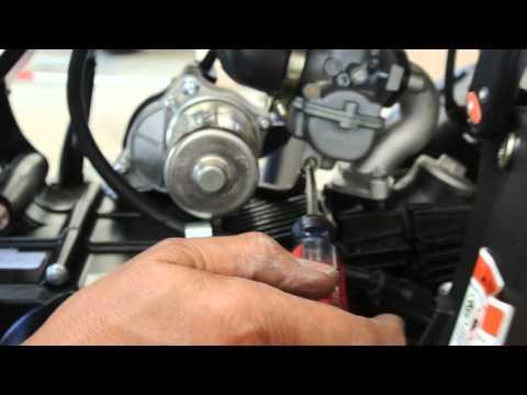 Carburetor drain plug on ATV
