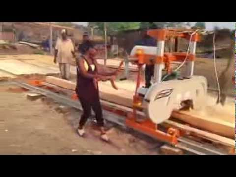 Saw Mill For Sale >> Norwood LumberMate LM29 Portable Band Sawmill milling lumber in Zambia - YouTube