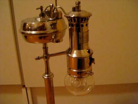 Lighting a Wiktorin self pressure alcohol table lamp