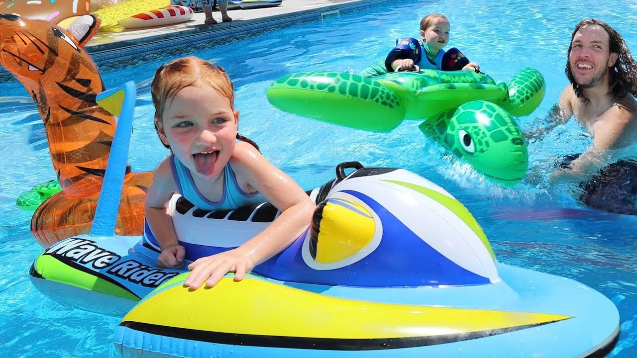 FAMiLY POOL PARTY!!  Adley & Niko Water Slide on inflatable Animals! Swimming in new AforAdley merch