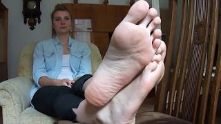 Pretty girl shows her huge feet (size 11)