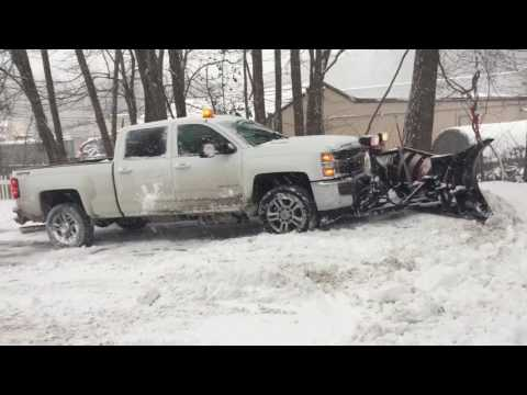 2015 chevy Silverado LT 2500 HD Duramax Diesel  and western MVP3 Plowing snow restaurant parking lot