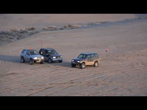 Suzuki Sidekick Sport on the sand dunes