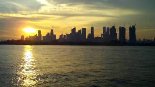 dinner cruise sunset over singapore skyline