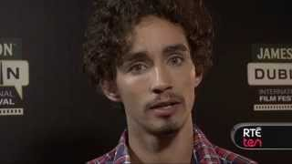 Robert Sheehan sings, reveals the best prank he's ever played & more.
