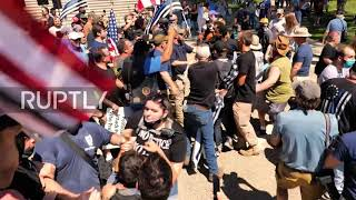 USA: Scuffles break out between opposing protesters at pro-police rally in Albany