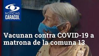 Vacunan contra COVID-19 a matrona de la comuna 13 que sobrevivió a la gripe española