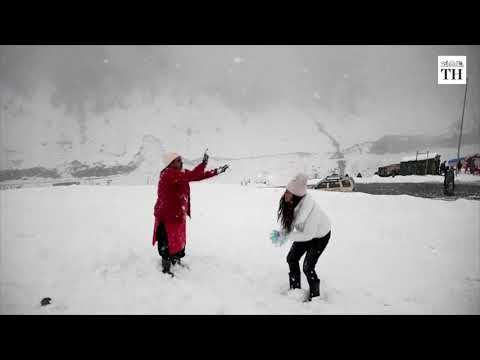 Kashmir's early snowfall attracts tourists