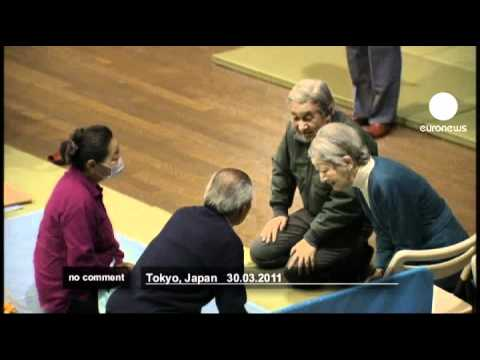 Japan's Emperor Akihito visits tsunami victims - no comment
