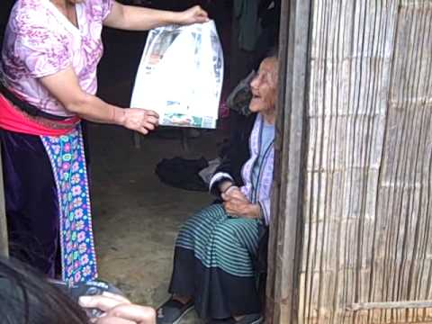 Hmong woman presented w/ newspaper clipping