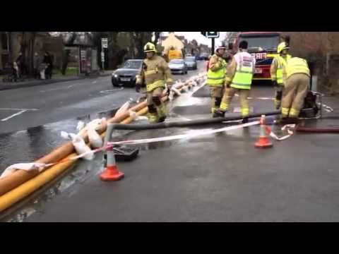 Firefighters pumping water out in Botley Road, Oxford, February 2014