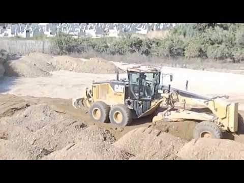 CAT 14M Motorgrader working Part 1