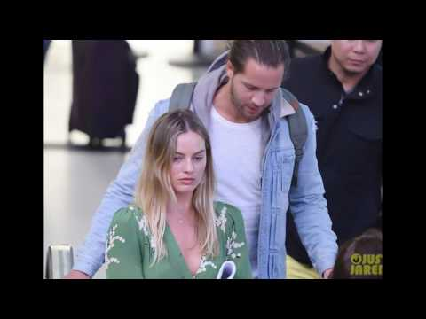 Margot Robbie & Tom Ackerley Arrive in New York City Together