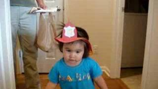 Kaysi Shows Daddy The Fireman Hat