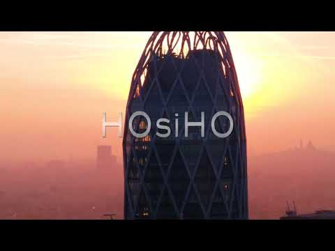 Aerial view of D2 Tower at sunrise in the Paris business district, filmed by drone, France